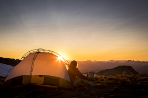 Woman camping on mountain | Camping in Canada